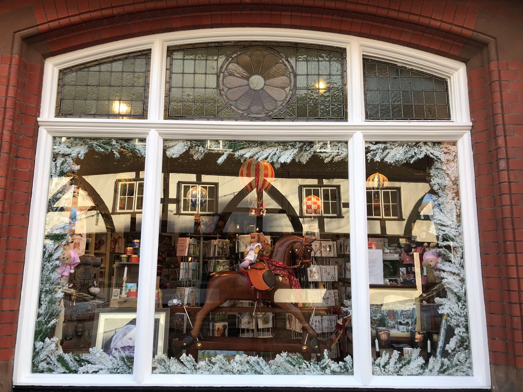 A shop window in Gloucester City centre decorated for Christmas